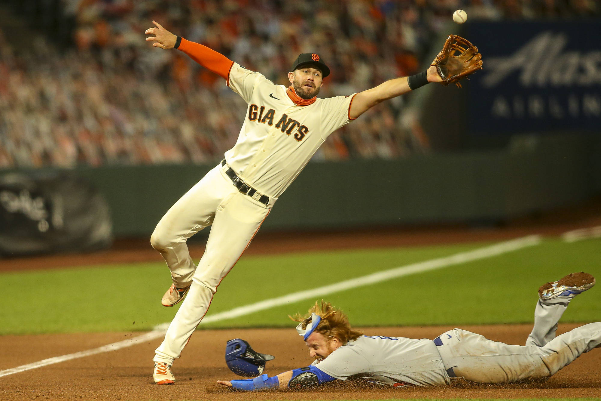 San Francisco Giants third baseman Evan Longoria (10) stretches to make a play at third base on a passed ball. (Chris Victorio | Special to S.F. Examiner).