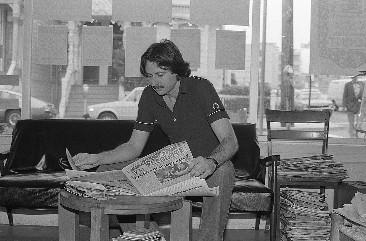 Longtime Mission resident and photographer Lou Dematteis reviews the October 1980 issue of El Tecolote. (Courtesy Lou Dematteis)