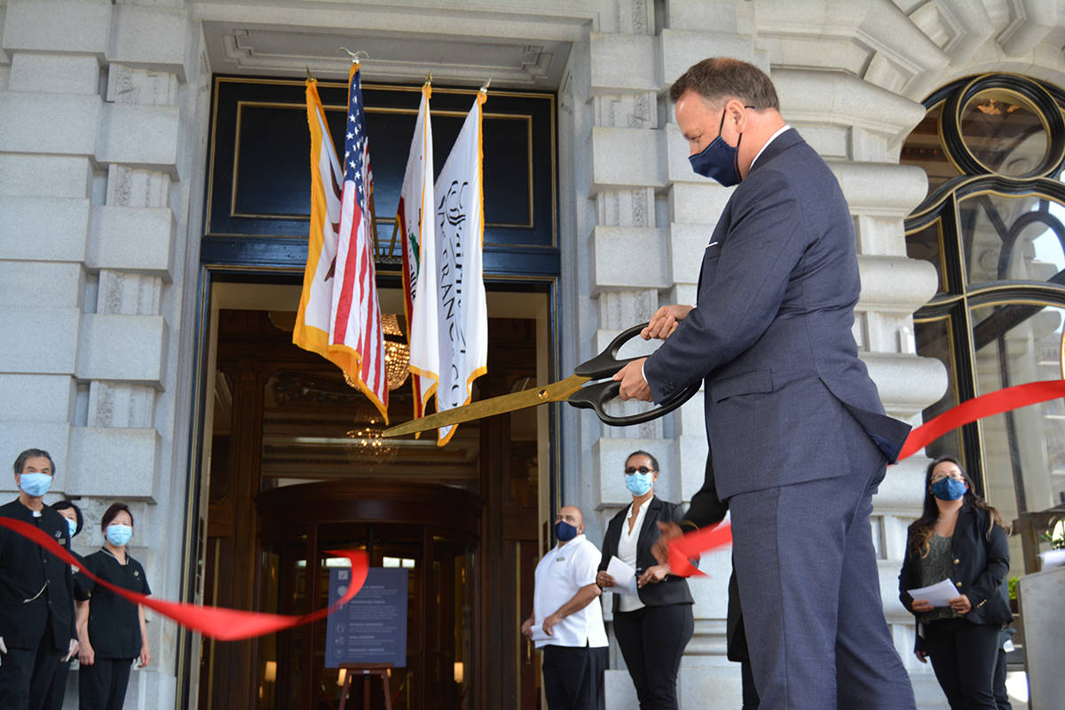 General manager Markus Treppenhauer cuts the ribbon as the Fairmont Hotel reopens. (Samantha Laurey/Special to S.F. Examiner)