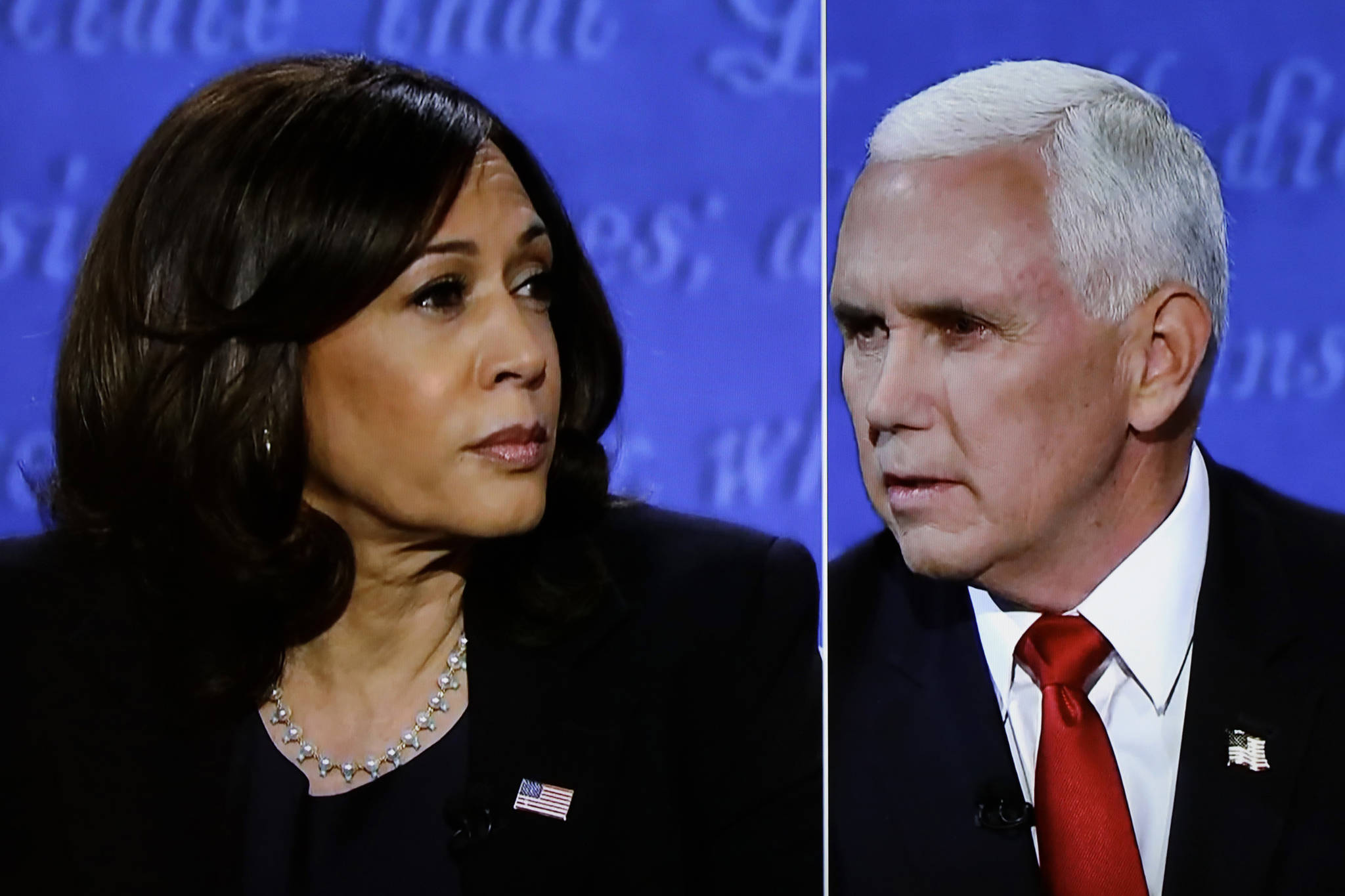 The vice presidential campaign debate between Democratic vice presidential nominee Sen. Kamala Harris (D-CA) and Vice President Mike Pence in Salt Lake City, Utah, is seen on TV in Washington, D.C., on Wednesday, Oct. 7, 2020. (Yuri Gripas/Abaca Press/TNS)