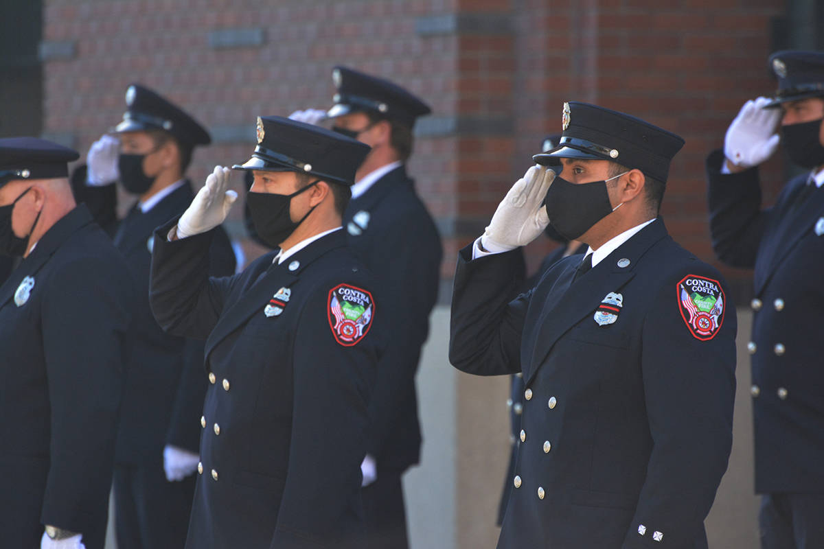 Contra Costa County firefighters salute San Francisco Firefighter Paramedic Jason Cortez. (Samantha Laurey/Special to S.F Examiner)