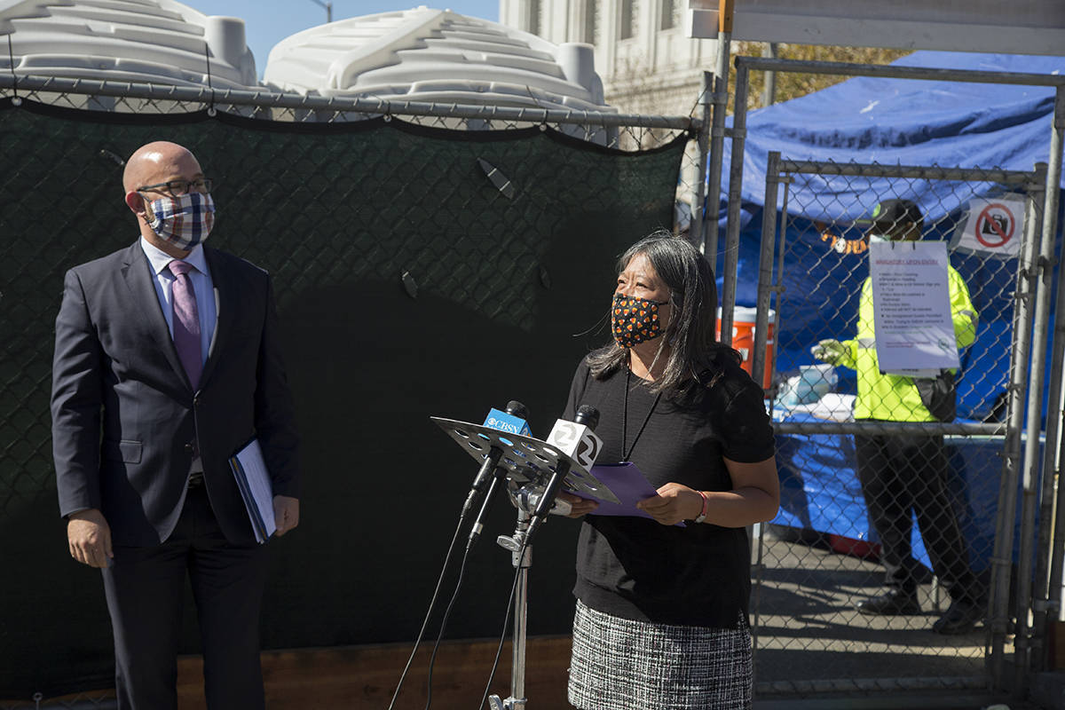 Supervisor Sandra Lee Fewer speaks at a news conference alongside Supervisor Rafael Mandelman where they announced legislation that would establish a Safe Sleeping Sites Program for unsheltered people outside the first Safe Sleeping Village at Civic Center on Tuesday, Oct. 20, 2020. (Kevin N. Hume/S.F. Examiner)