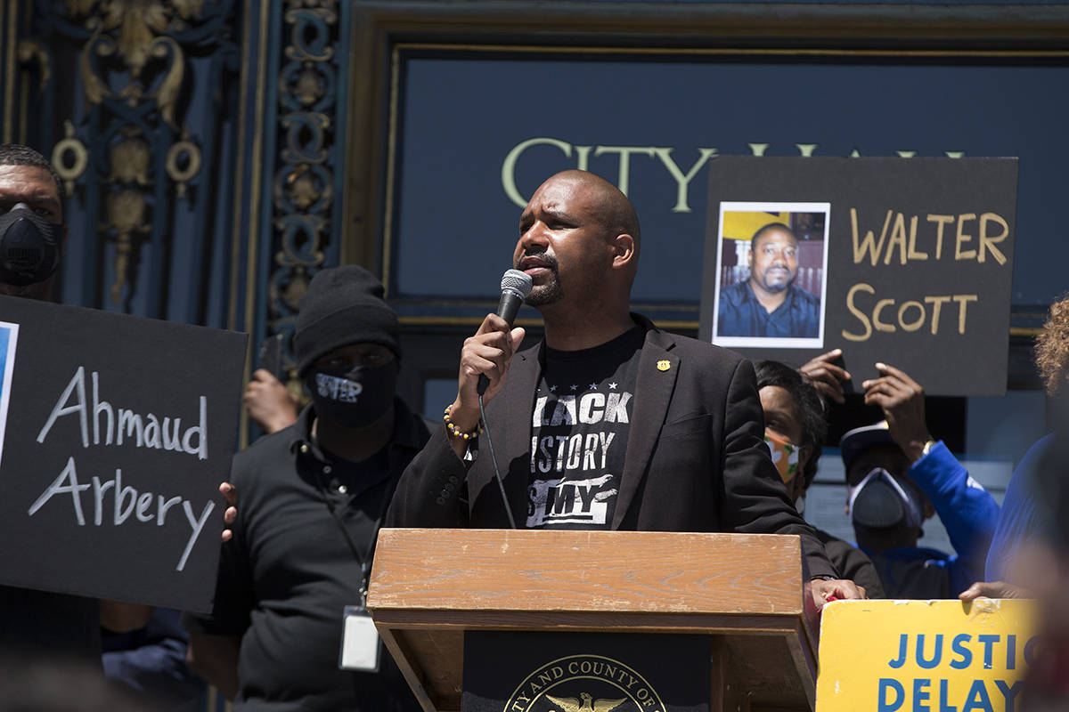 Supervisor Shamann Walton, pictured at a June rally to commemorate the life of George Floyd and others killed by police, introduced legislation Tuesday that would create a 15-member advisory board charged with creating a plan for reparations.  Kevin N. Hume/ S.F. Examiner