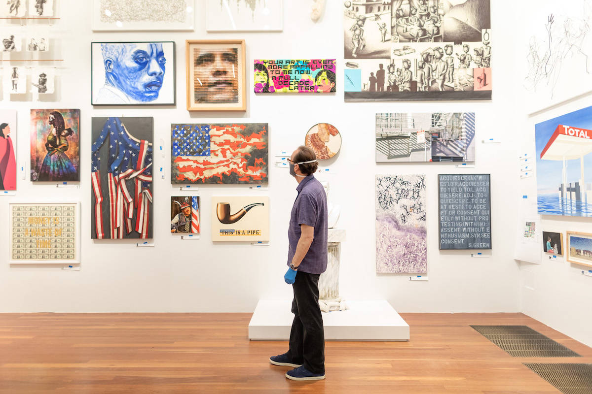 "Curator Tim Burgard looks over a section of the galleries comprising ""The de Young Open,"" a huge, varied collection of work by Bay Area artists. (Photo courtesy Gary Sexton/Fine Arts Museums of San Francisco)"