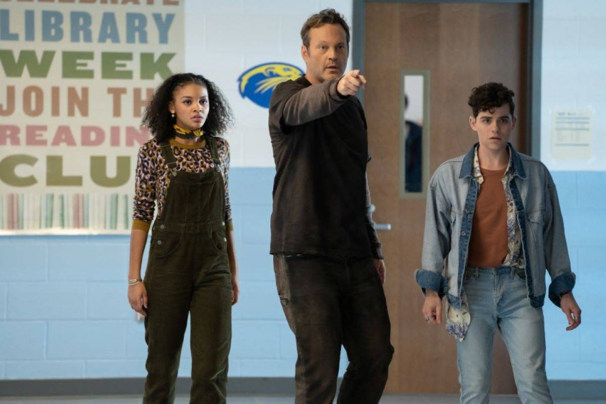 """Vince Vaughn, center, plays both a killer known as the Butcher and a high school student with whom he switches bodies, in """"Freaky."""" (Courtesy Brian Douglas / Universal)"""