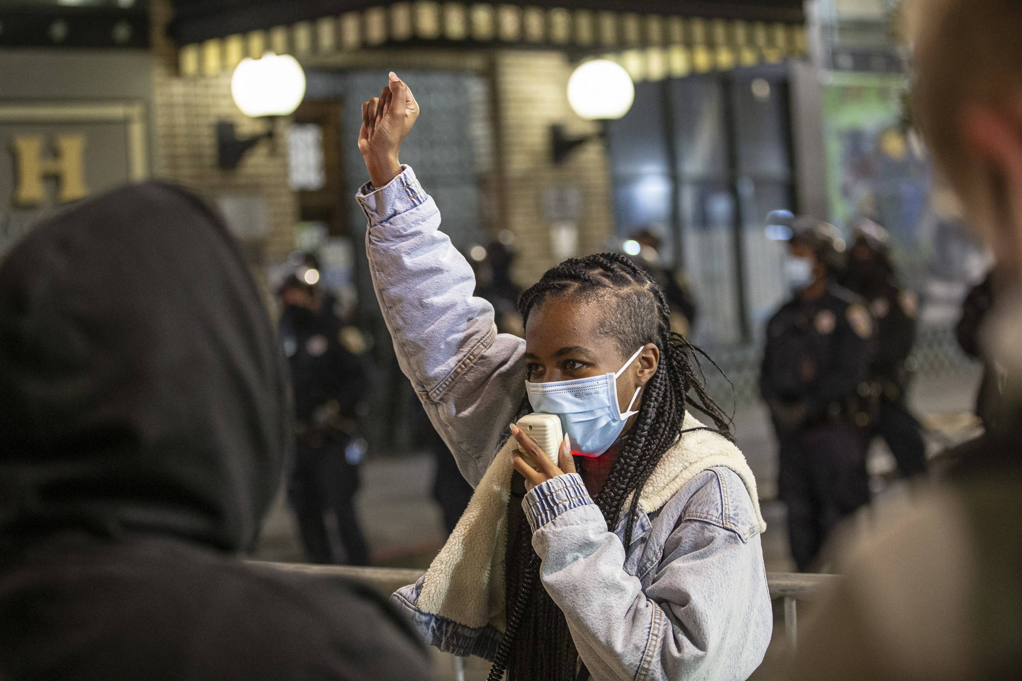 Alex Kamir (center) rallies protesters after they are met with a police line outside the Tenderloin Police Station Thursday night. (Chris Victorio | Special to the S.F. Examiner).