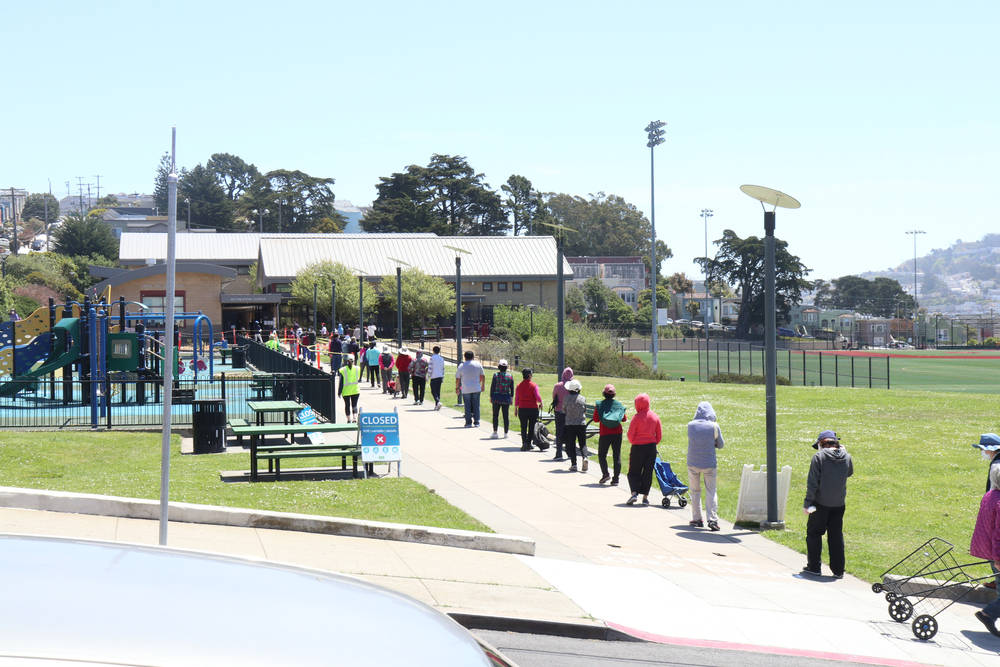 Long lines have developed at food banks during the pandemic and subsequent financial crisis, as seen here at the Minnie & Lovie Ward Recreational Center in May of this year. (Shutterstock)