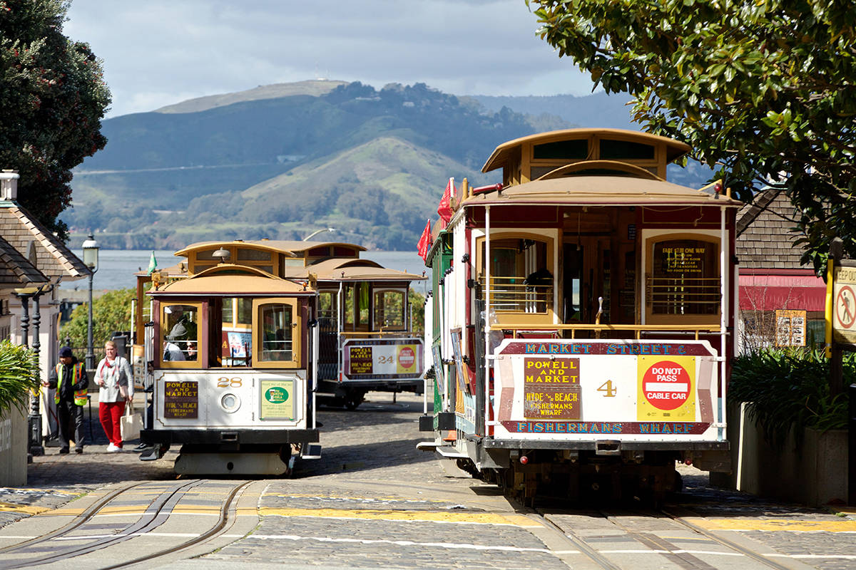 Those who stick around San Francisco on long holiday weekends can enjoy a slower pace, uncrowded streets and beloved institutions like cable cars. <ins>(Kevin Hume/S.F. Examiner)</ins>