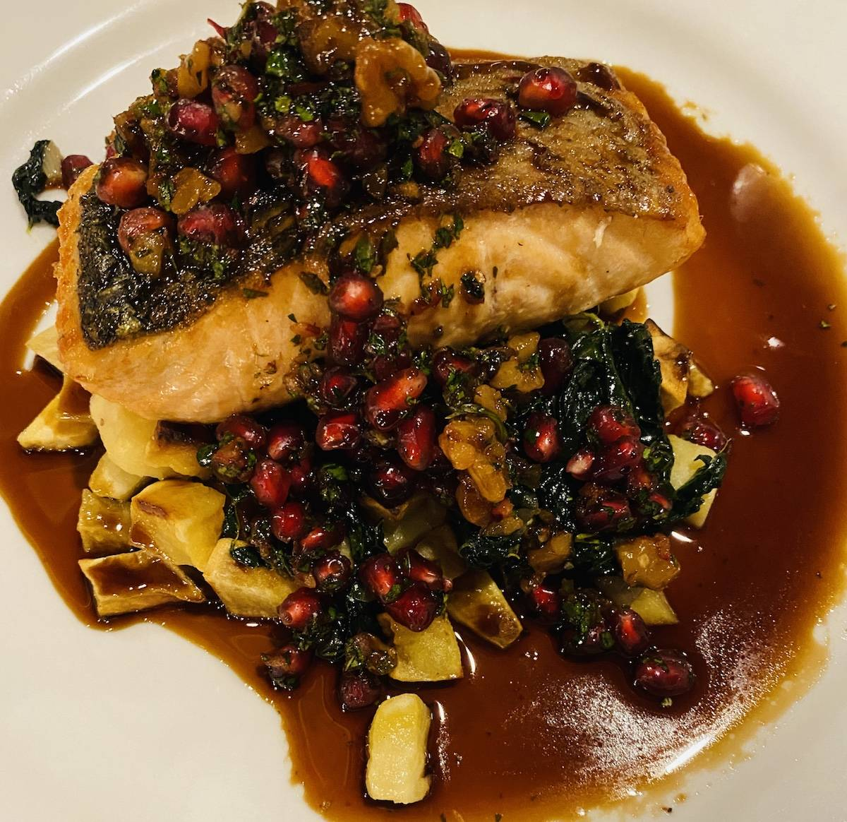 Wild Skuna Bay salmon with pomegranate and walnut salsa was tangy and tasty. (Julie L. Kessler/Special to S.F. Examiner)