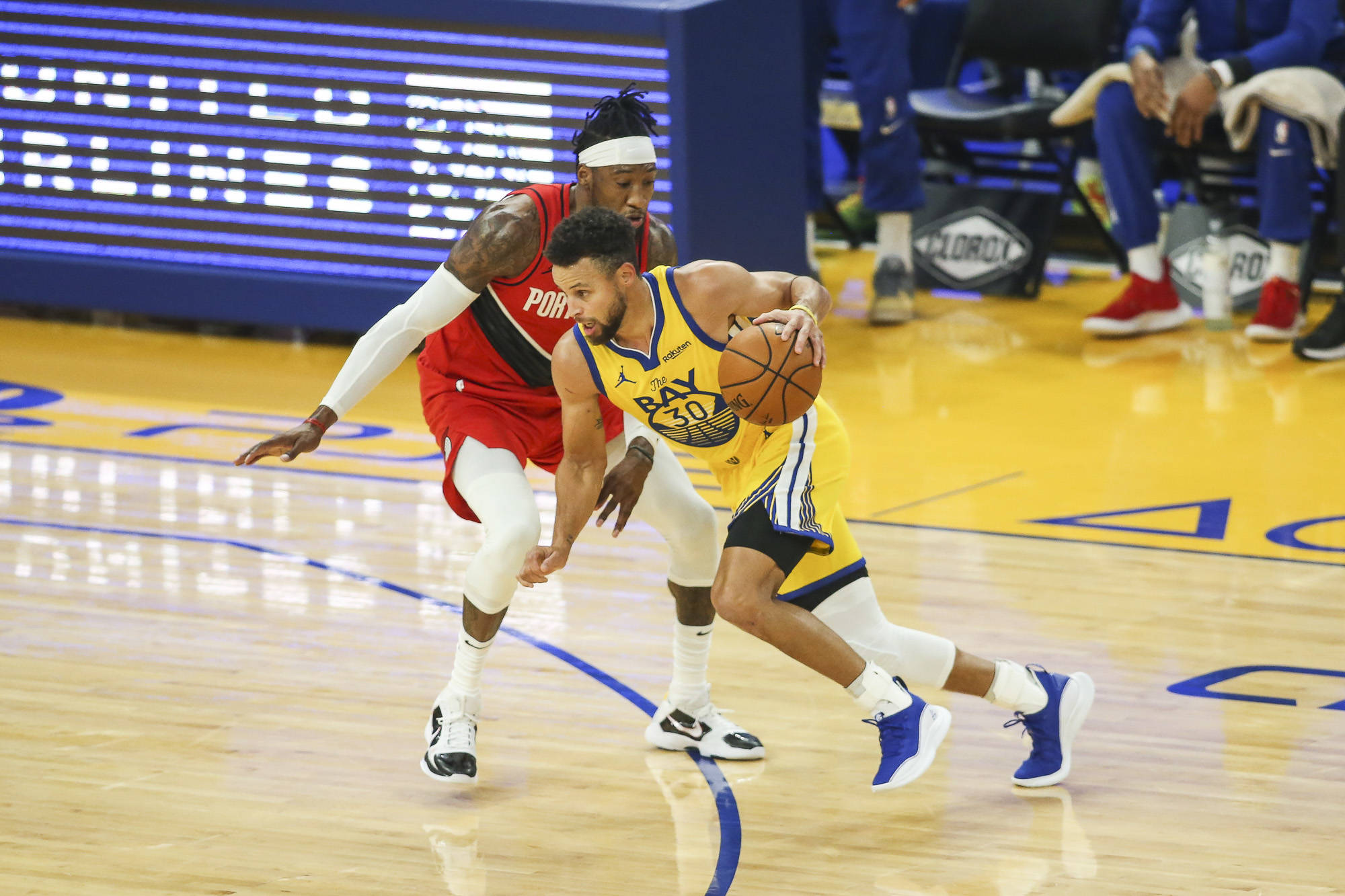 Golden State Warriors point guard Stephen Currey (30) gets trailed by Portland Blazers forward Robert Convington (23) in the 1st quarter at Chase Center on January 3, 2021 in San Francisco, California.(Chris Victorio | Special to the S.F. Examiner).
