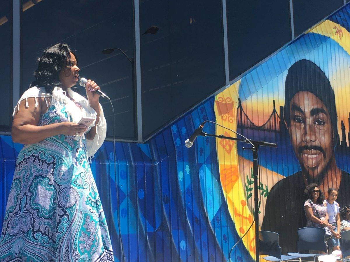 Wanda Jackson stands next to a mural in 2019 at Fruitvale Station of her son Oscar Grant, who was shot and killed by BART police in 2009. (Laura Waxmann/S.F. Examiner)