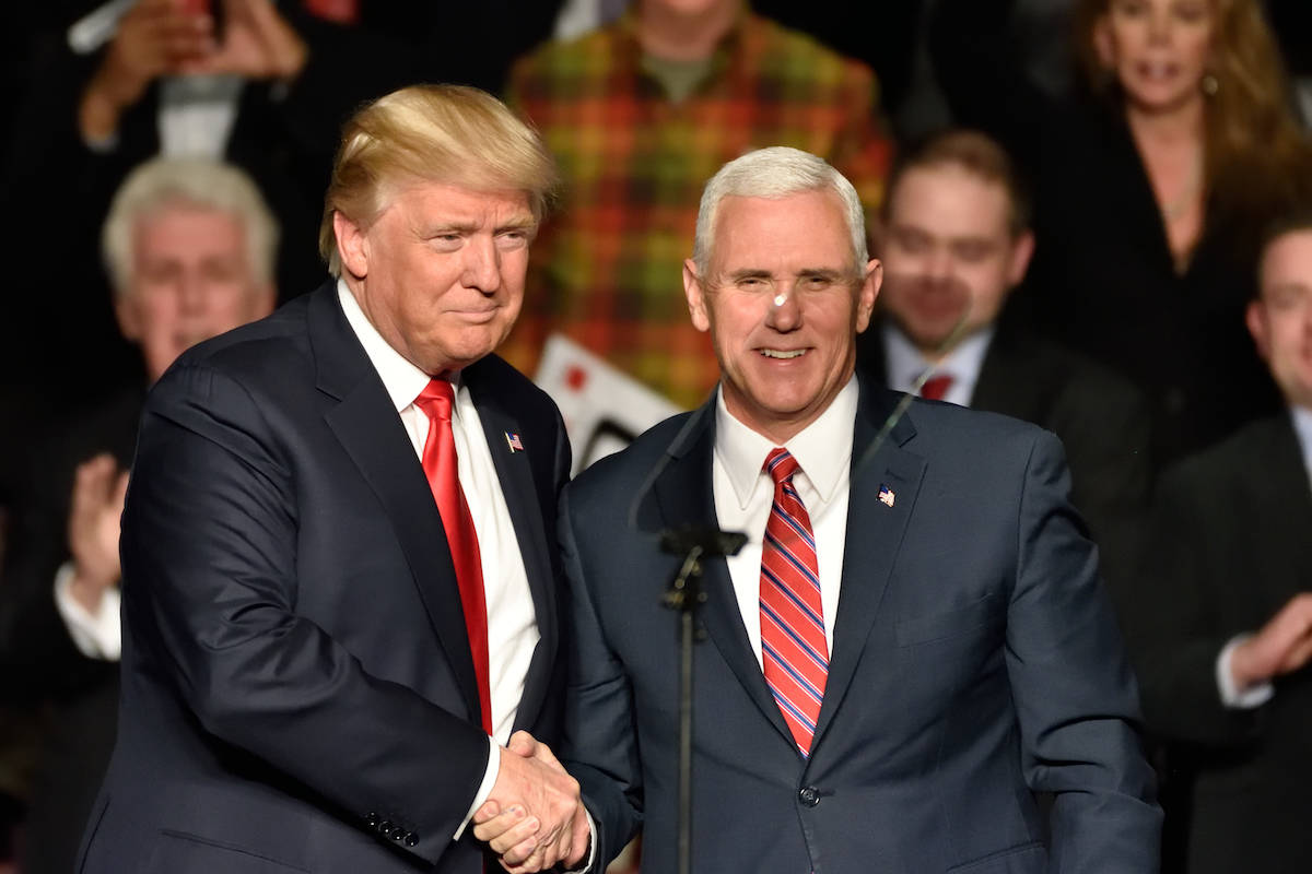 Under the 25th Amendment, Vice President Mike Pence, right, could replace President Donald Trump.<ins> (Shutterstock)</ins>