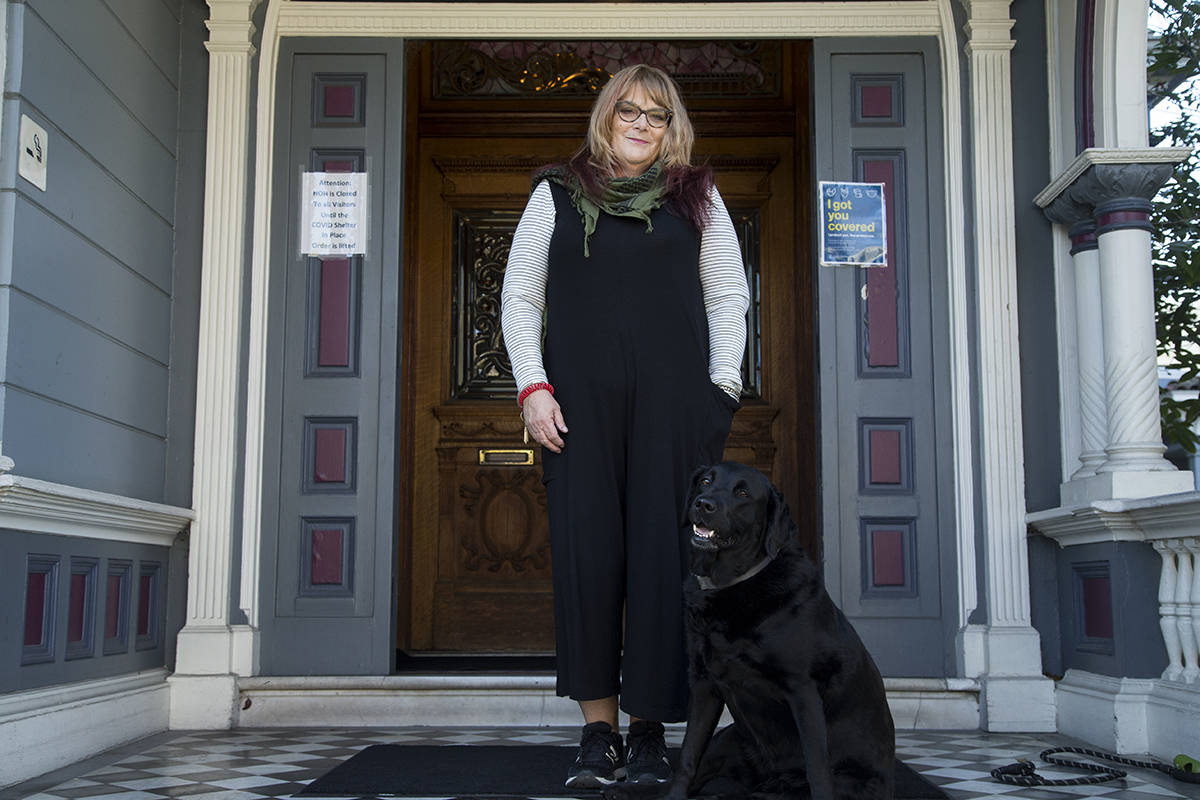 Toni Isabella, a counselor at Ohlhoff Recovery Programs, finds helpful assistance from service dog Barker Posey. (Kevin N. Hume/S.F. Examiner)