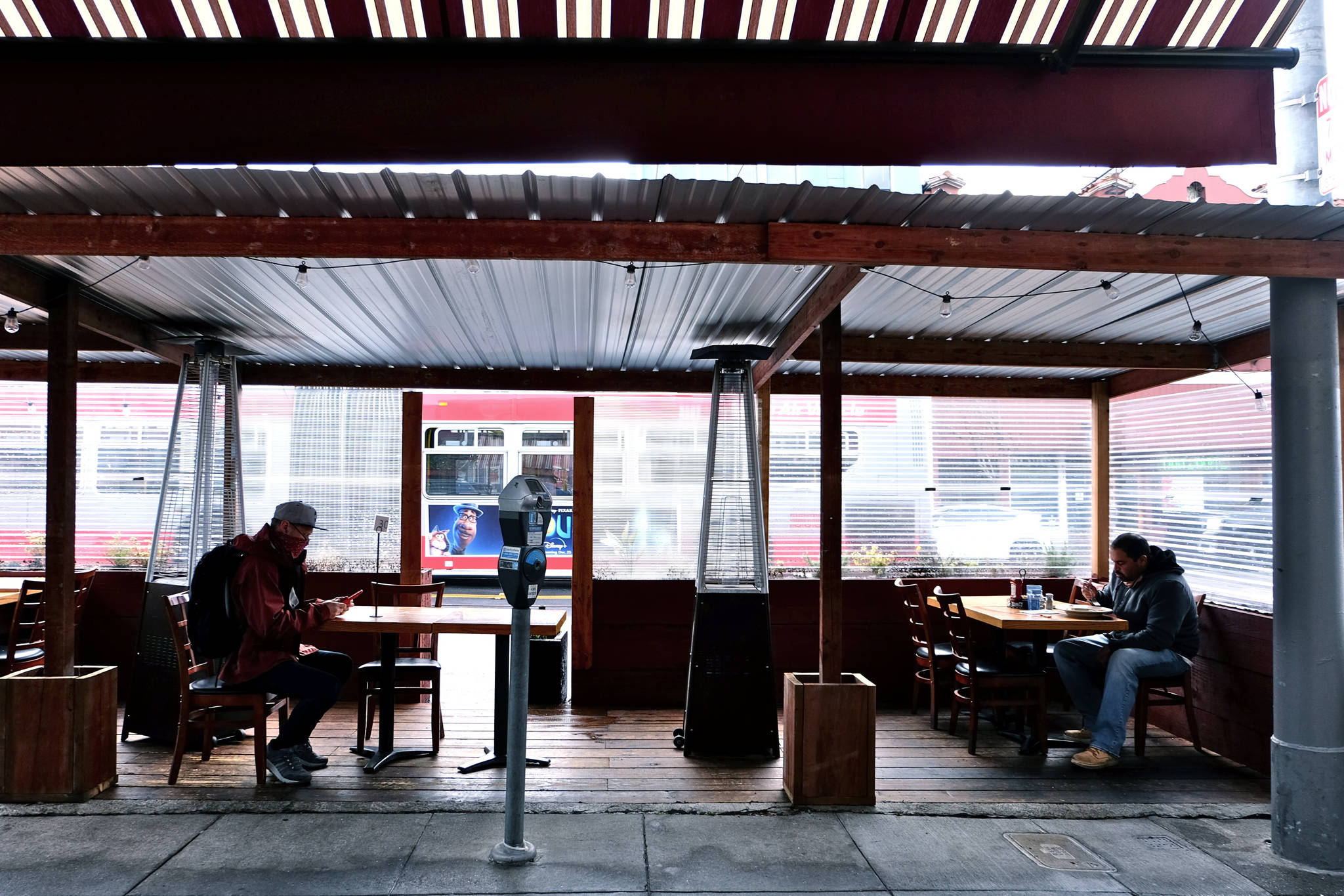Patrons sit down for an early lunch at Crepevine in the Inner Sunset District on January 28, 2021, the day that outdoor dining in San Francisco resumed. (Kevin Kelleher/Special to the S.F. Examiner)