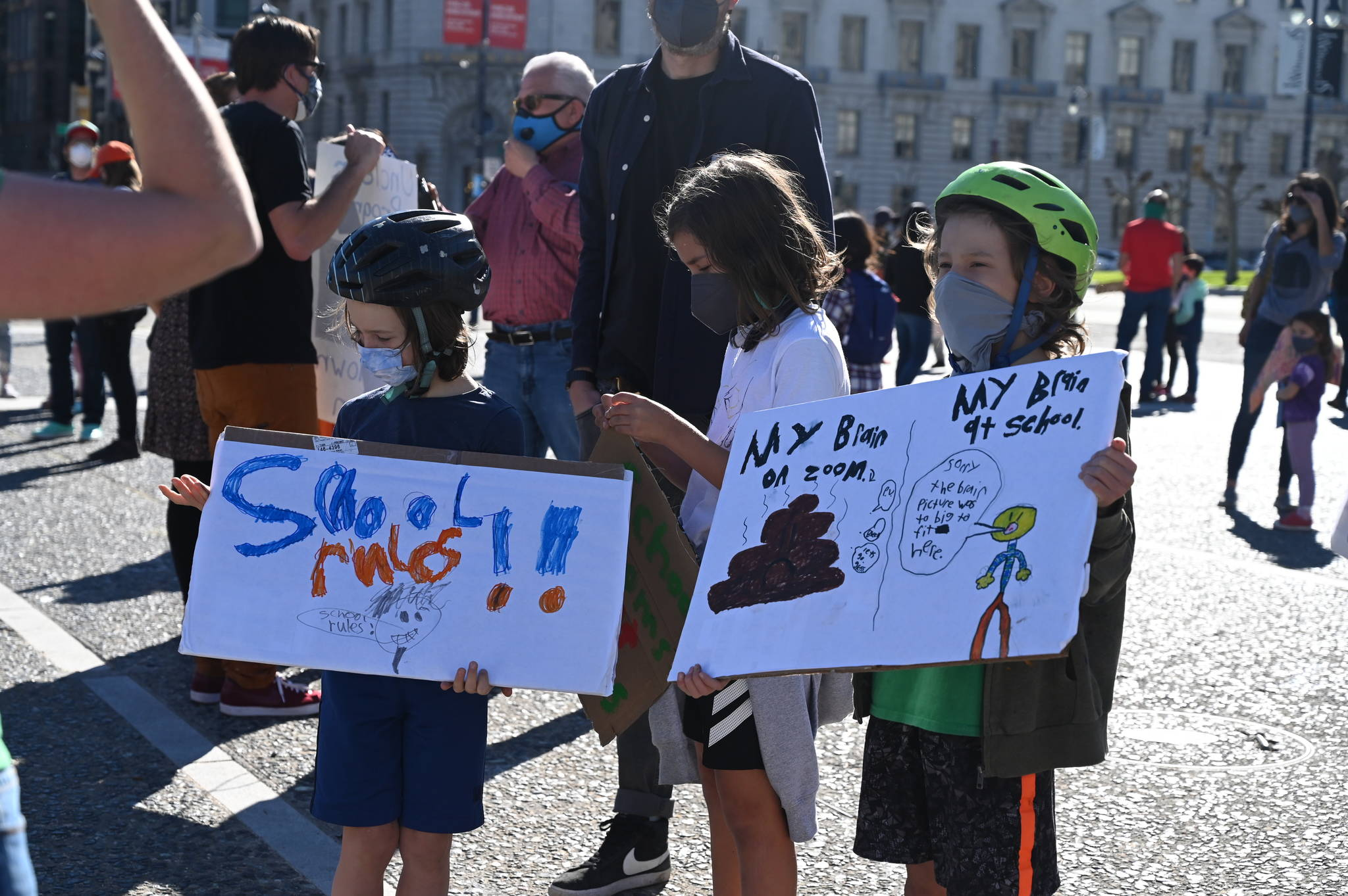 Kids hold signs as they prepare to march from the front of City Hall to SFUSD offices at 555 Franklin St. (Samantha Laurey/Special to SF Examiner)