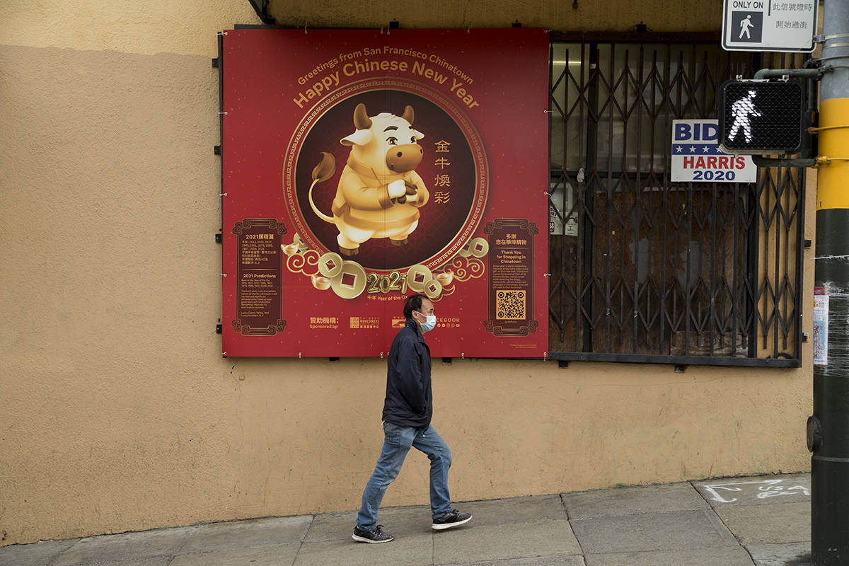A sign for the Year of the Ox hangs at the corner of Stockton and Clay streets in Chinatown during a subdued holiday season. (Kevin N. Hume/S.F. Examiner)