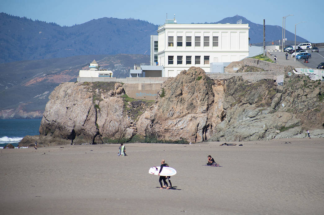 The now-shuttered Cliff House restaurant overlooks Ocean Beach people at Ocean Beach on Tuesday, Feb. 23, 2021. (Sebastian Miño-Bucheli / Special to the S.F. Examiner)