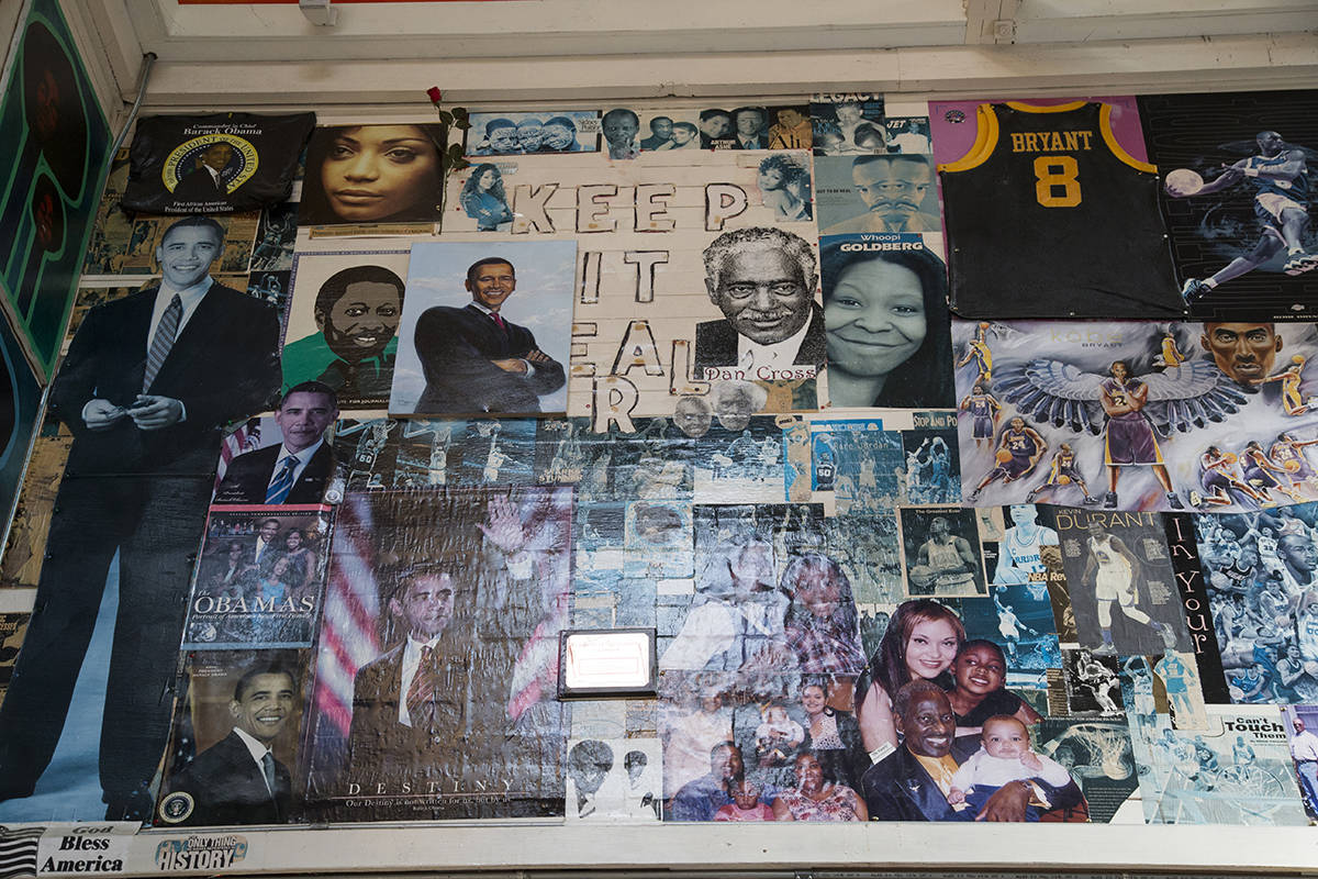 """Prominent Black leaders are pictured in the main collage inside the Rev. Roland Gordon Fellowship Hall, part of the """"Great Cloud of Witnesses"""" collage at the Ingleside Presbyterian Church. (Kevin N. Hume/S.F. Examiner)"""