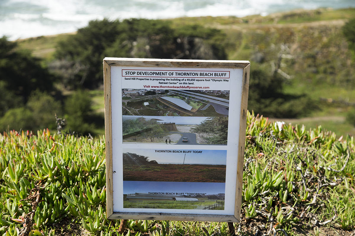 A sign about proposed development of the bluff at Thornton State Beach in Daly City on Friday, Feb. 26, 2021. (Kevin N. Hume/S.F. Examiner)