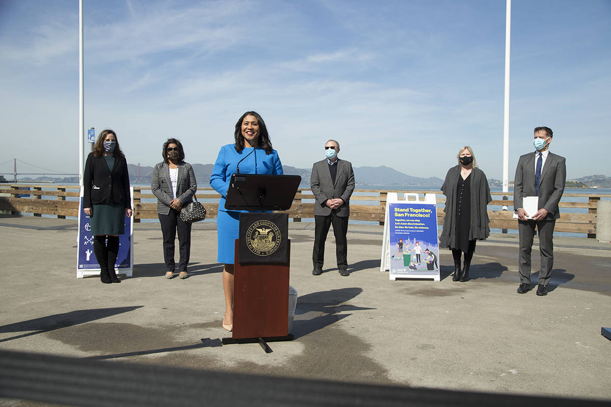 Mayor London Breed announces The City's return to the red tier for COVID-19 precautions at Pier 39 on Tuesday, March 2, 2021. (Kevin N. Hume/S.F. Examiner)