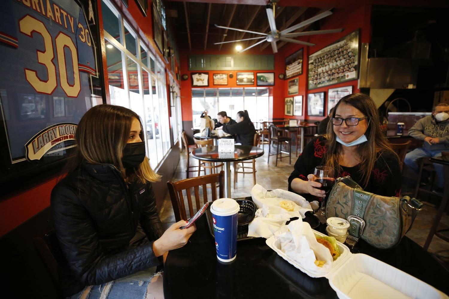 Brandi Harrapence, right, has lunch with her daughter Kayla Harrapence inside Firestone Grill in the heart of downtown San Luis Obispo, open for inside dinning for the first time in nearly a year, on Wednesday, March 3, 2021 in San Luis Obispo, California. (Al Seib/Los Angeles Times/TNS)