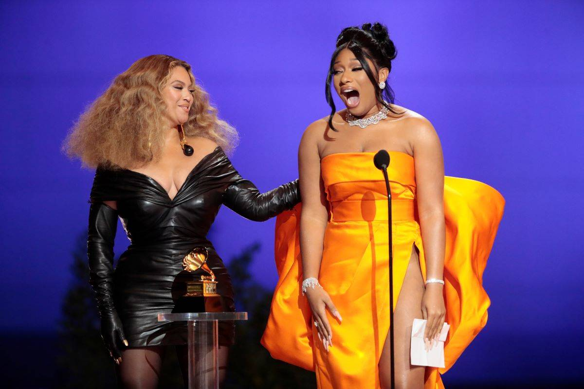 Beyonce and Megan Thee Stallion accepted the award for Best Rap Album at the 63rd Grammy Awards in Los Angeles on Sunday. (Robert Gauthier/Los Angeles Times/TNS) \
