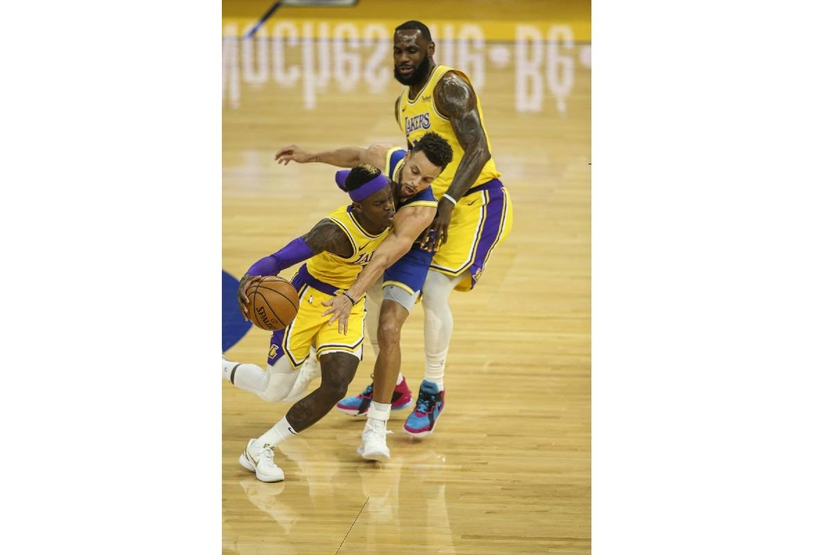 Los Angeles Lakers forward LeBron James (23) gets called for an offensive foul on Golden State Warriors point guard Steph Curry (30) in the first quarter at Chase Center on March 15. (Chris Victorio/Special to S.F. Examiner)