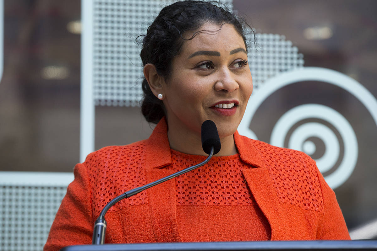 Mayor London Breed announced The City's entrance into the less-restrictive COVID orange tier at a news conference at Rincon Plaza on Tuesday.  Kevin N. Hume/ S.F. Examiner