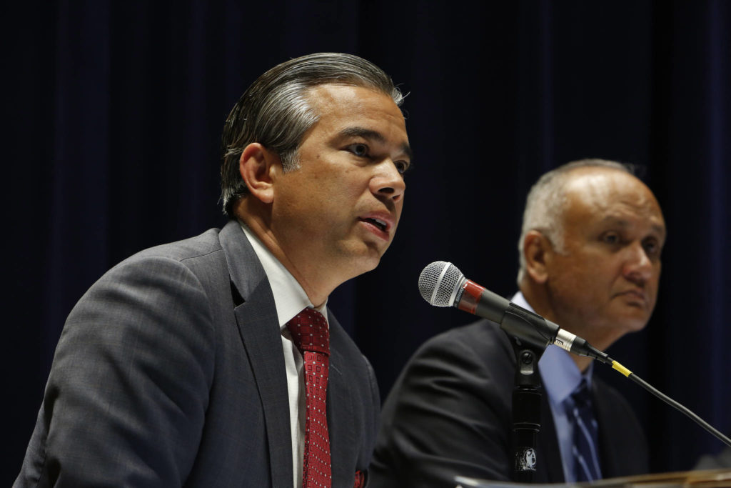 California Assemblyman Rob Bonta, left, pictured in 2015, has been chosen by California Gov. Gavin Newsom as the state's new attorney general; State Sen. Ed Hernandez is at right. (Katie Falkenberg/Los Angeles Times/TNS)