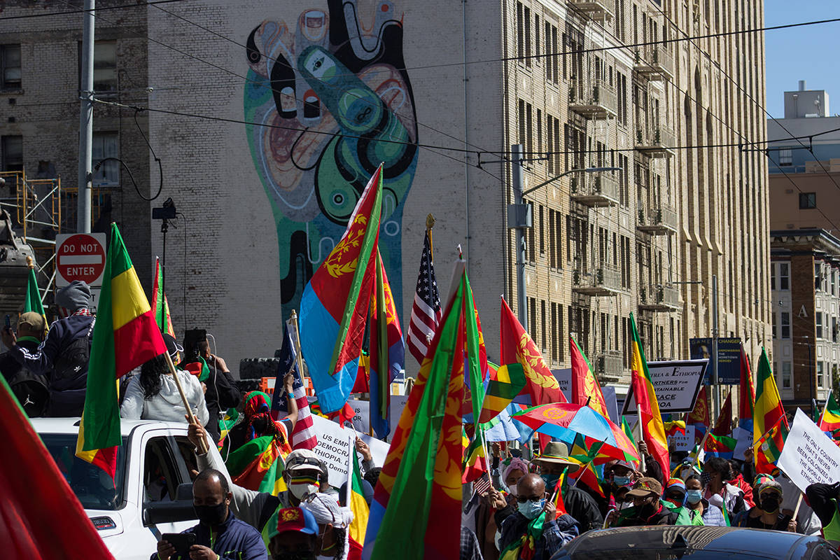 Marchers with the Be the Voice for Ethiopia demonstration head up McAllister Street toward City Hall on Friday, March 26, 2021. (Jordi Molina/ Special to the S.F. Examiner)