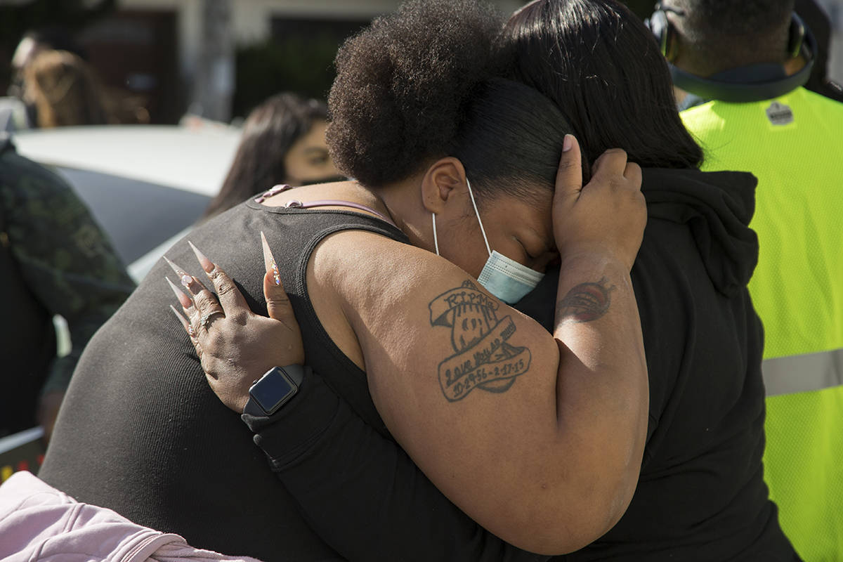 Talika Fletcher, sister of Roger Allen, is consoled at a vigil to honor her brother, who was killed by Daly City Police on April 7, on Wednesday, April 14, 2021. (Kevin N. Hume/S.F. Examiner)