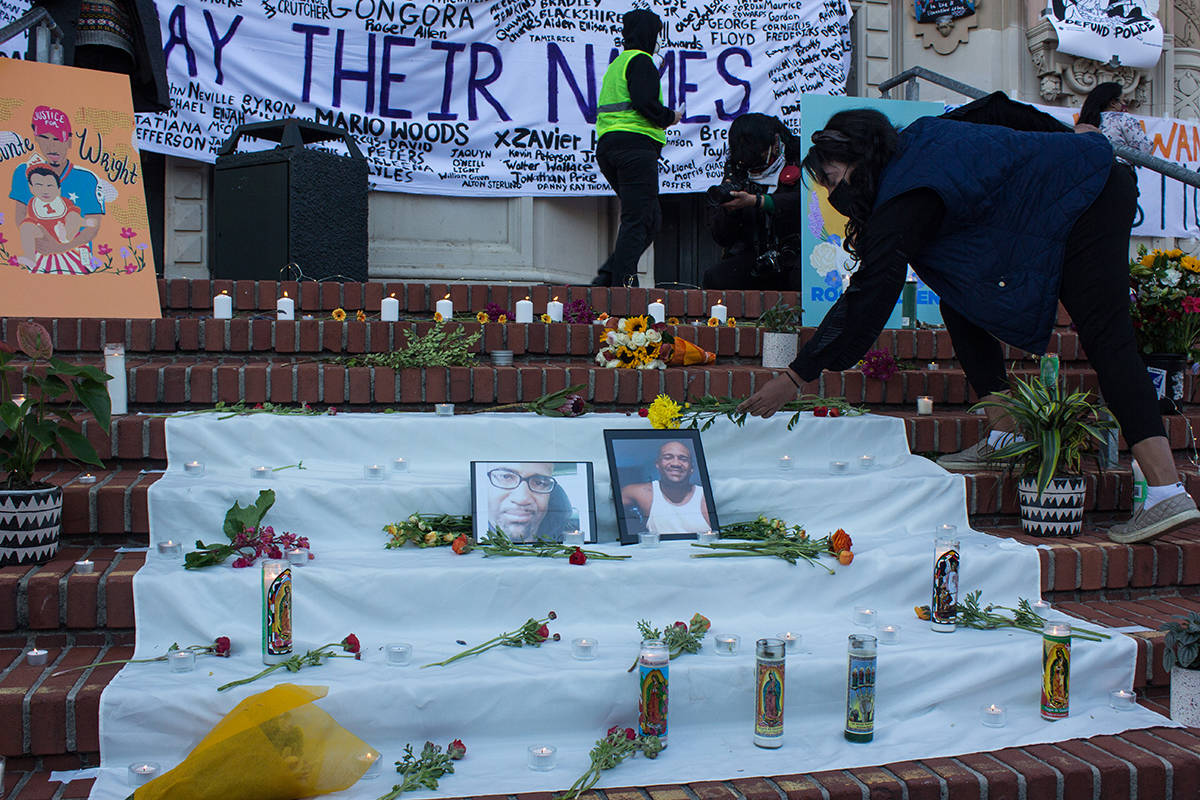 """A woman placed flowers on a memorial to honor Roger Allen, Daunte Wright and other victims of police killings at Mission High School on Thursday. <ins>(Jordi Molina/Special to S.F. Examiner)</ins>""""/></a></figure>    <p>A woman placed flowers on a memorial to honor Roger Allen, Daunte Wright and other victims of police killings at Mission High School on Thursday. (Jordi Molina/Special to S.F. Examiner)</p>    <figure class="""