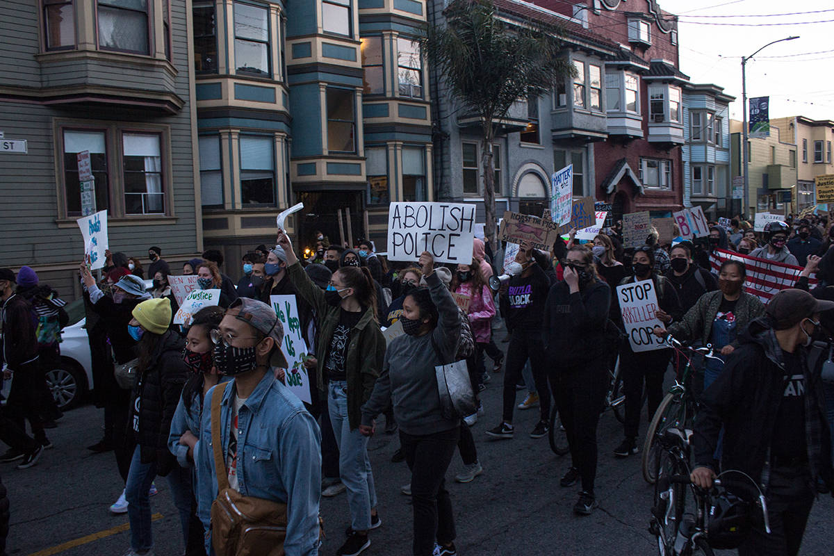 Demonstrators march from Mission High School towards the San Francisco Police station on Valencia Street. (Jordi Molina/ Special to the S.F. Examiner)