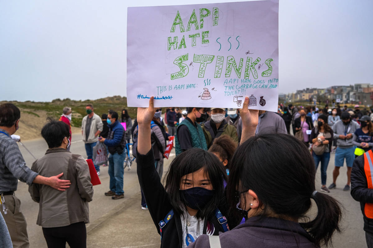 Amelie Huynh expresses her views at the March for AAPI Solidarity and Safety on Sunday, April 18, 2020. (Camille Cohen / Special to SF Examiner)