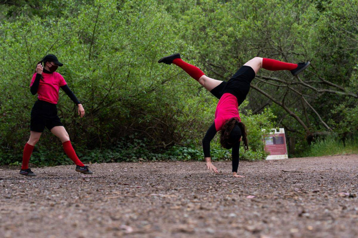 """From left, Katherine Neumann and Erin Yen make their way down a path in """"Diffusion."""" (Courtesy Robbie Sweeny)"""