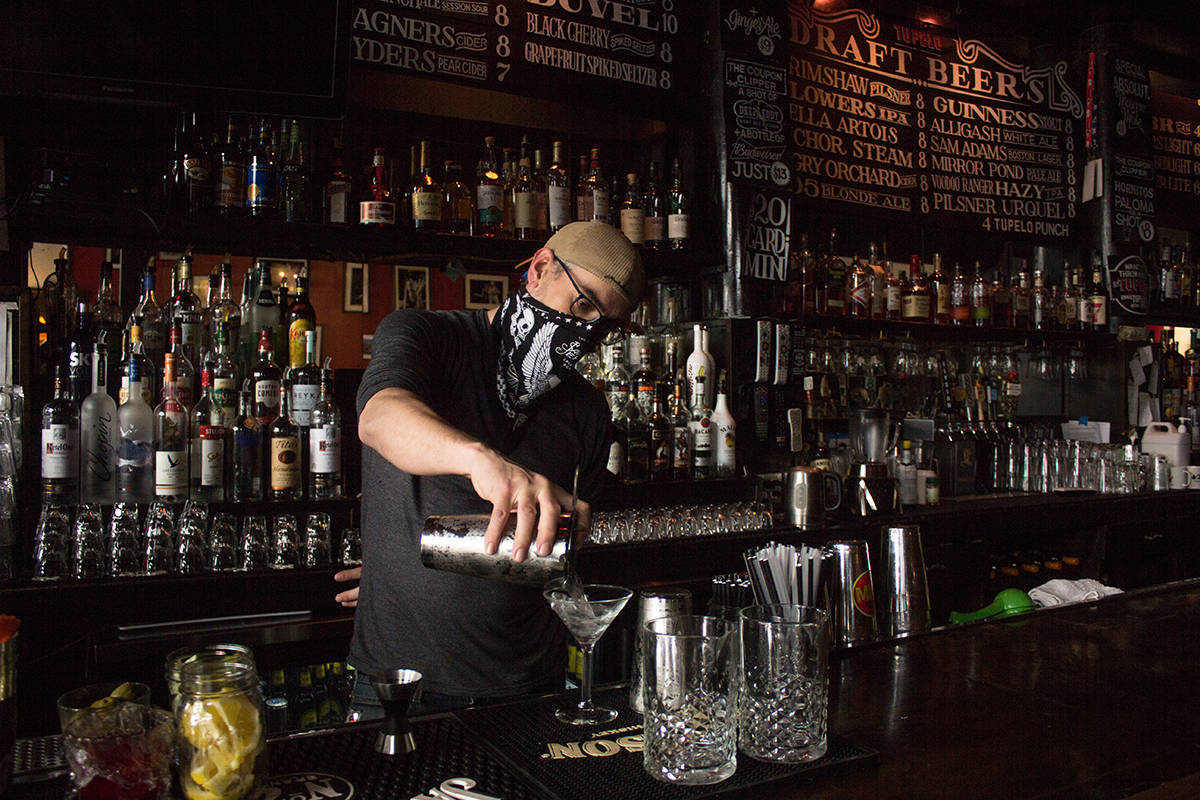 Logan Hesse prepares a cocktail at Tupelo bar in North Beach on Thursday, May 6, 2021 after The City entered the Yellow Tier, allowing bars to reopen at 25-percent capacity. (Jordi Molina/ Special to the S.F. Examiner)