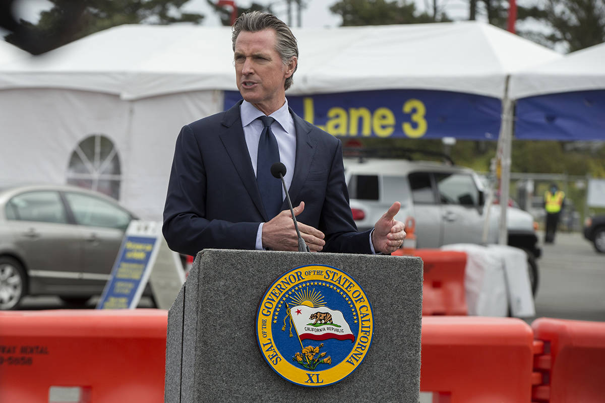 Gov. Gavin Newsom, show here speaking at the City College of San Francisco mass vaccination site in April, faces a recall election due to anger on the right over his handling of the pandemic, among other issues. (Kevin N. Hume/S.F. Examiner)