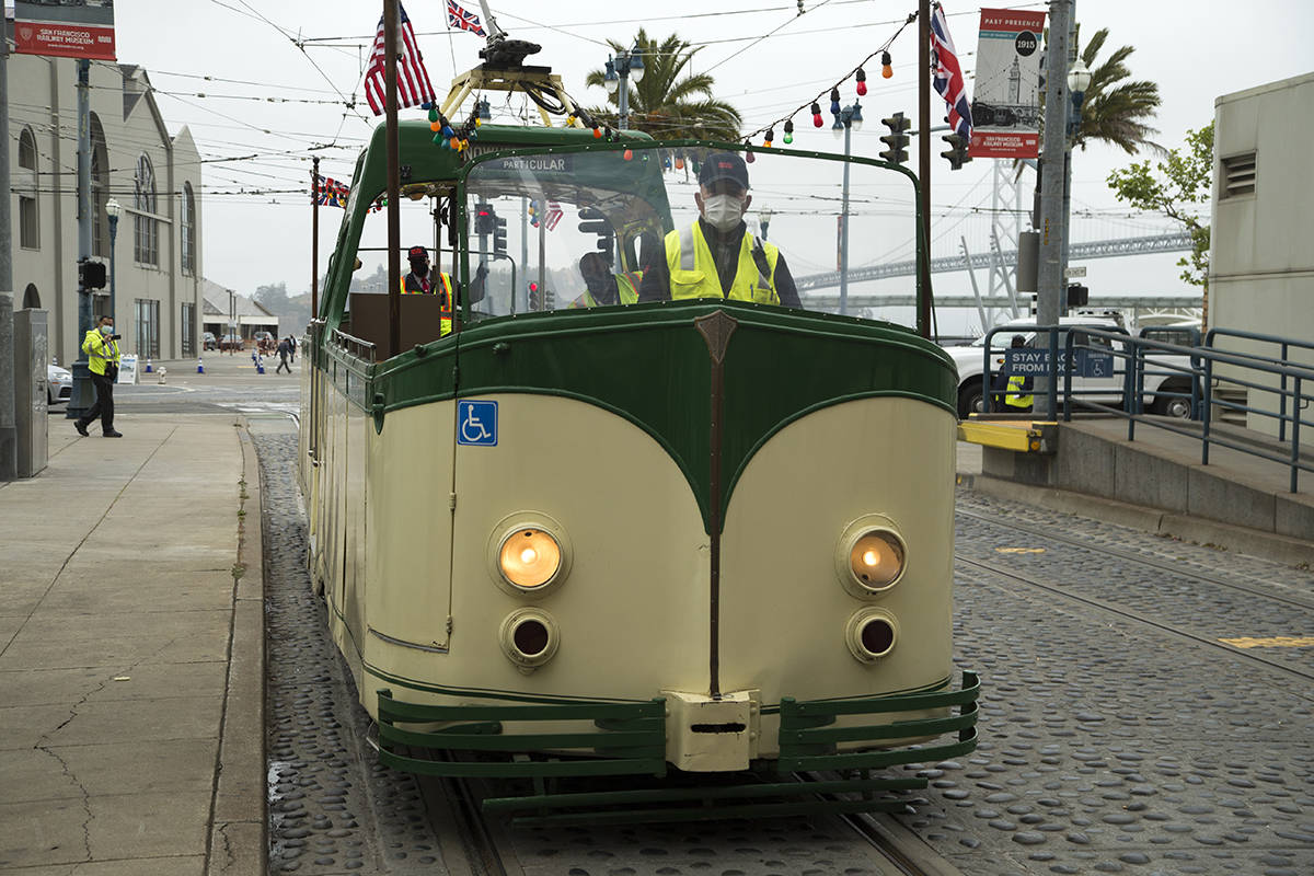 Muni operator Angel Carvajal drives the popular boat tram following a news conference celebrating the return of the historic F-line and subway service on Friday, May 14, 2021. (Kevin N. Hume/S.F. Examiner)