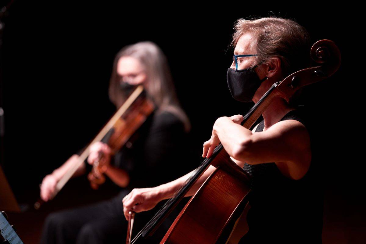 """New Century Chamber Orchestra players Jenny Douglass, left, and Michelle Djokic appear in the group's virtual """"Resonance Series"""" of free performances; streaming starts on May 27. (Courtesy David Law)"""