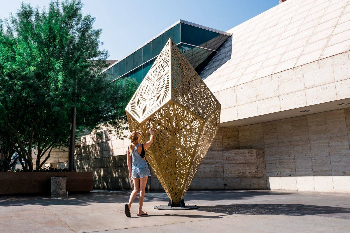 Meredith Winner in Las Vegas in front of the sculpture InSpire by HYBYCOZO. (Courtesy Maximillian Rainey)