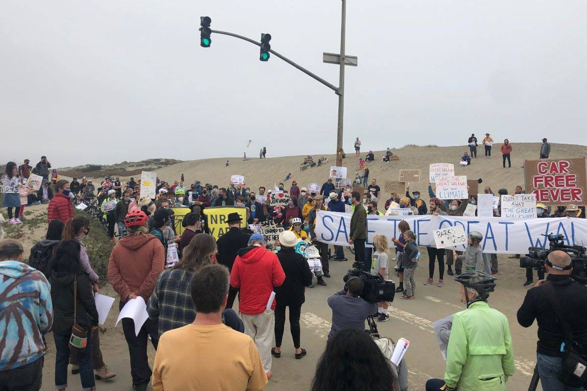 """San Franciscans supporting the """"Great Walkway"""" — who oppose the recent reopening of a portion of the Great Highway to vehicle traffic — rallied on Aug. 15. (Robyn Purchia/Special to The Examiner)"""