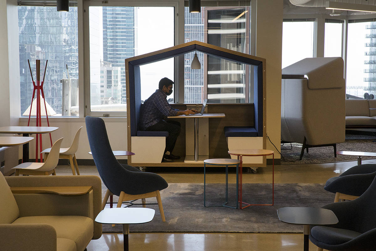 Srikanth Seshadri works in an enclosed workspace on a mostly empty floor at cybersecurity company Okta's San Francisco offices on Thursday, Aug. 26, 2021. (Kevin N. Hume/The Examiner)