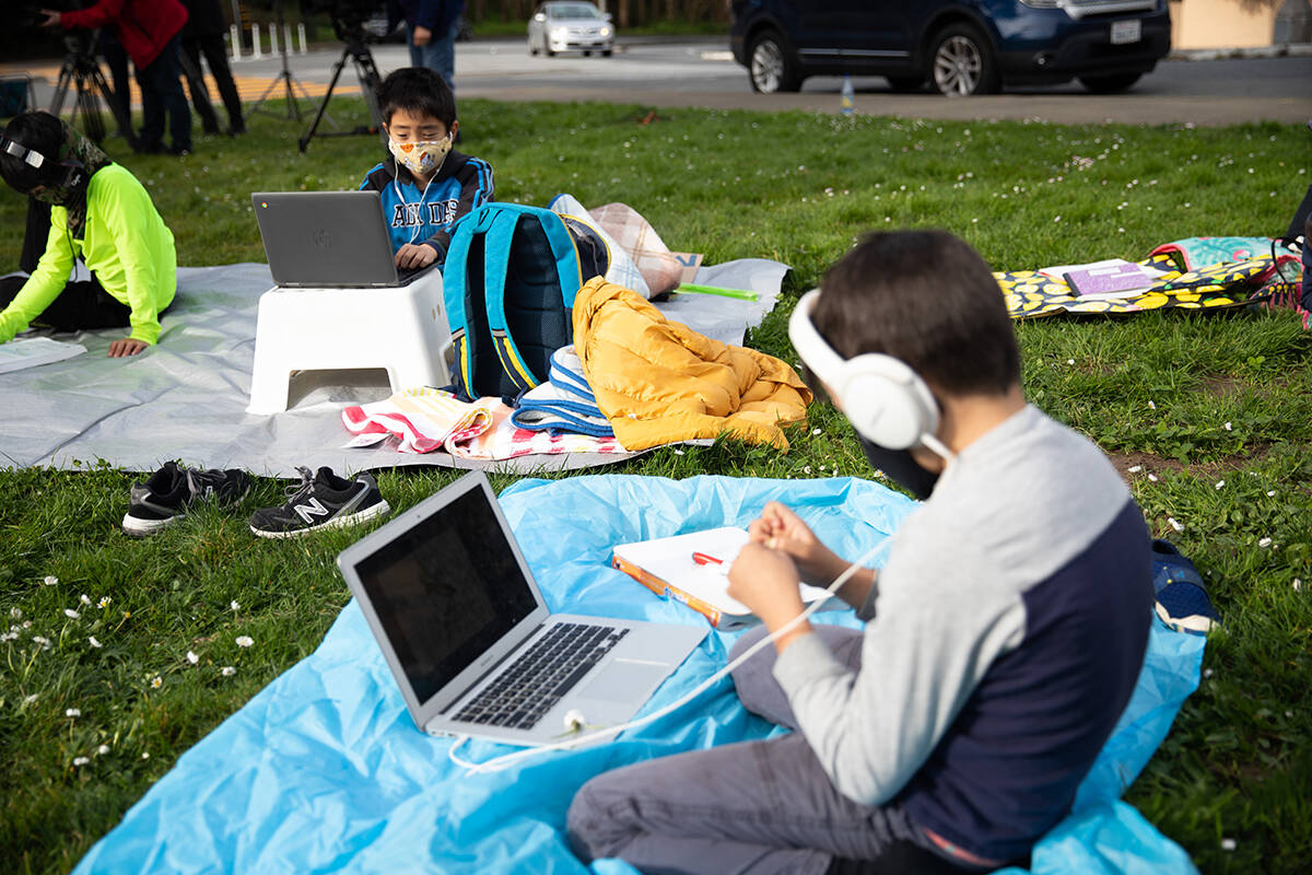 """Students take part in their remote learning classes at Midtown Terrace Park during the Decreasing the Distance """"Zoom In"""" demonstration in San Francisco. (Sebastian Miño-Bucheli / Special to S.F. Examiner)"""