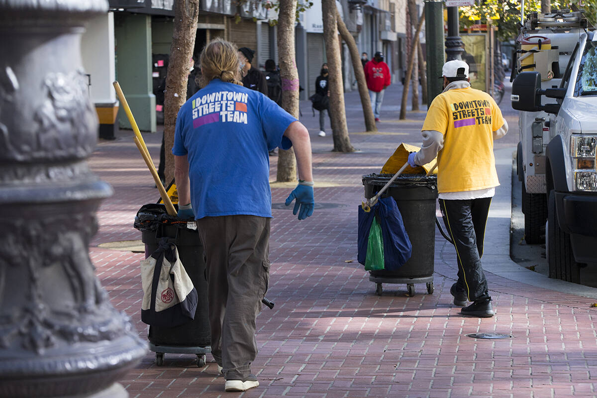 Downtown Streets Team workers collect trash on Market Street in the Mid-Market area. (Kevin N. Hume/The Examiner)