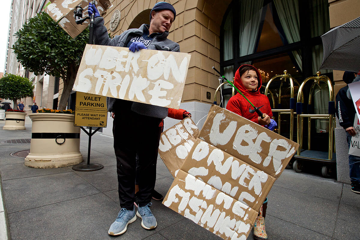 In 2019, Uber and Lyft drivers demonstrated seeking better wages; their classification as independent contractors, rather than employees, remains while gig worker-companies challenge a judge's ruling calling Proposition 22, which allowed for such classification, unconstitutional.<ins> (Kevin N. Hume/Examiner file)</ins>