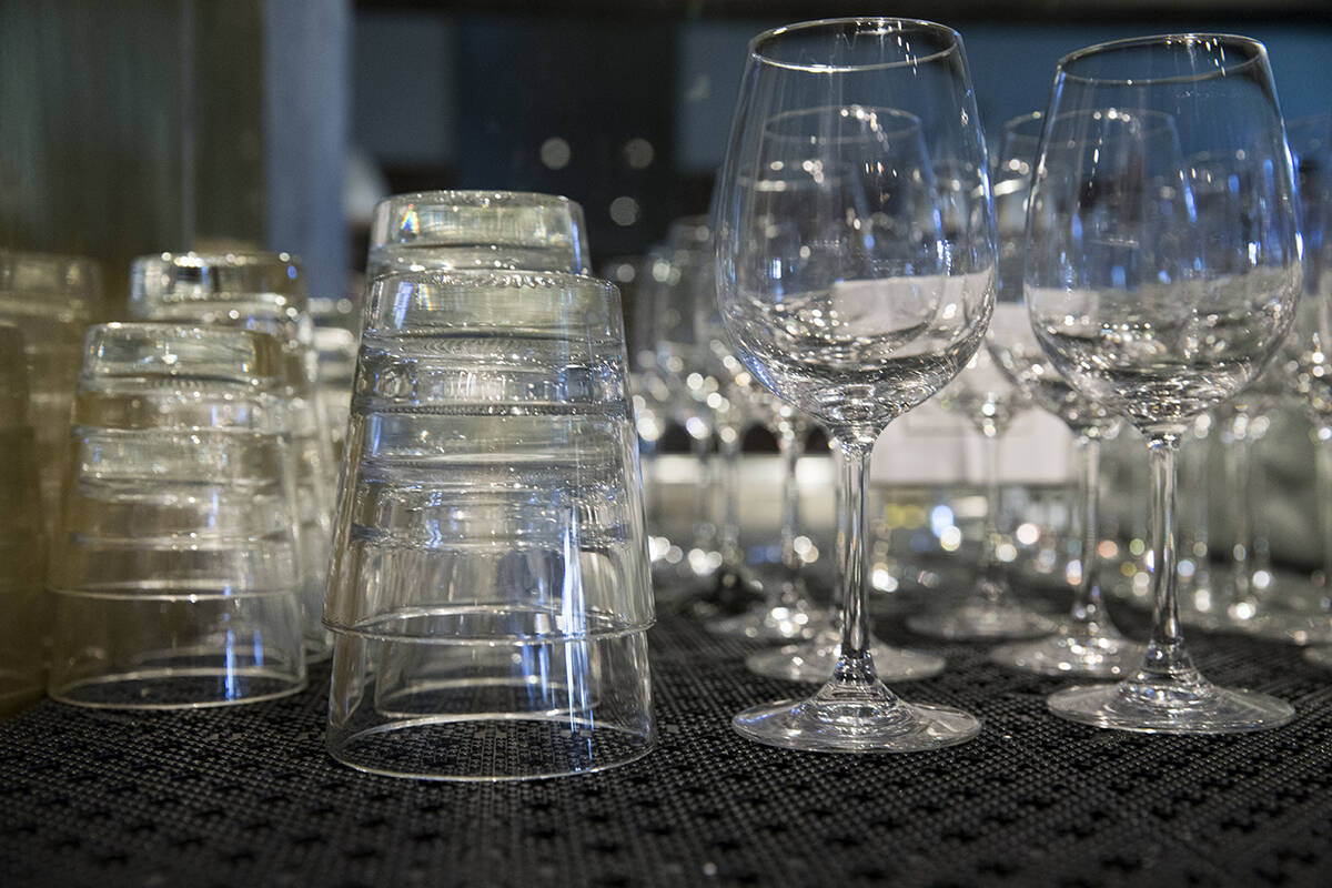 Glasses behind the bar at LUNA in the Mission District on Friday, Oct. 15, 2021. Glassware is just one of the many things restaurants have had trouble keeping in stock as supply chain problems ripple outward. (Kevin N. Hume/The Examiner)