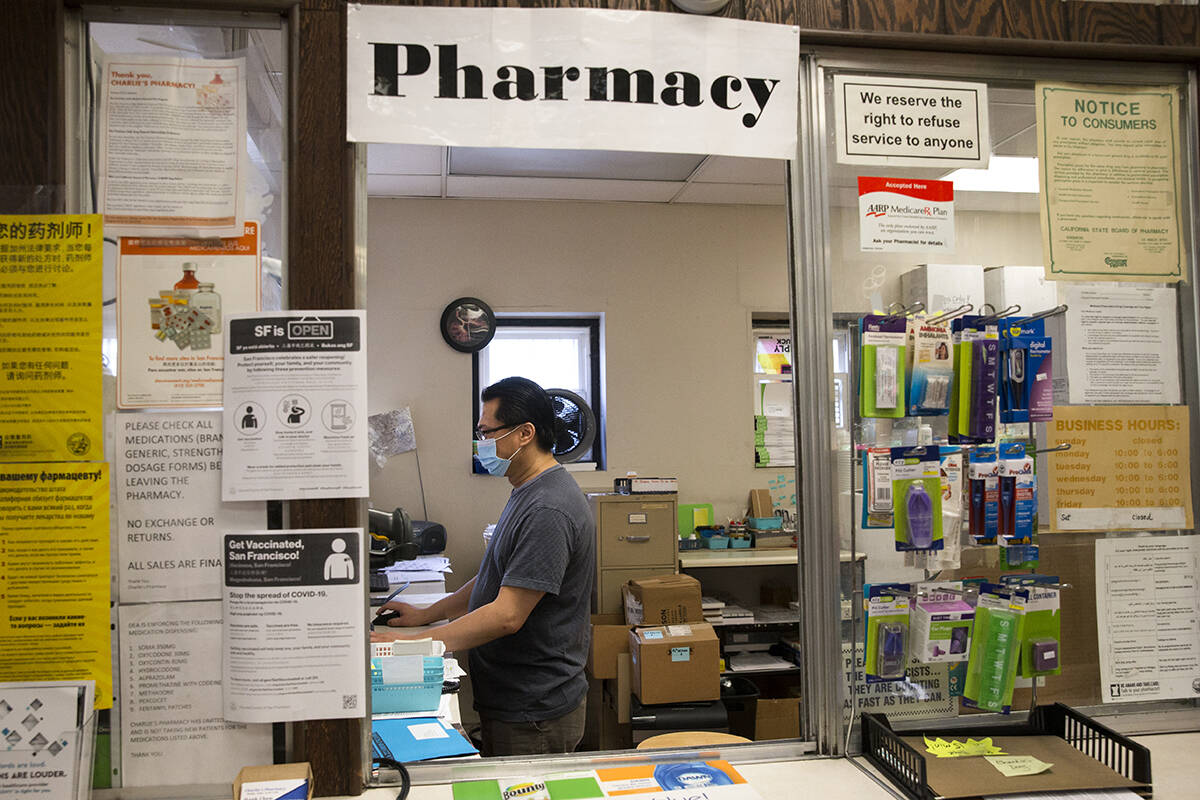 Pharmacist Hank Chen is known for providing personalized service at Charlie's Pharmacy in the Fillmore.<ins> (Kevin N. Hume/The Examiner)</ins> Left: A Walgreens at 300 Gough St. is among San Francisco stores closing.