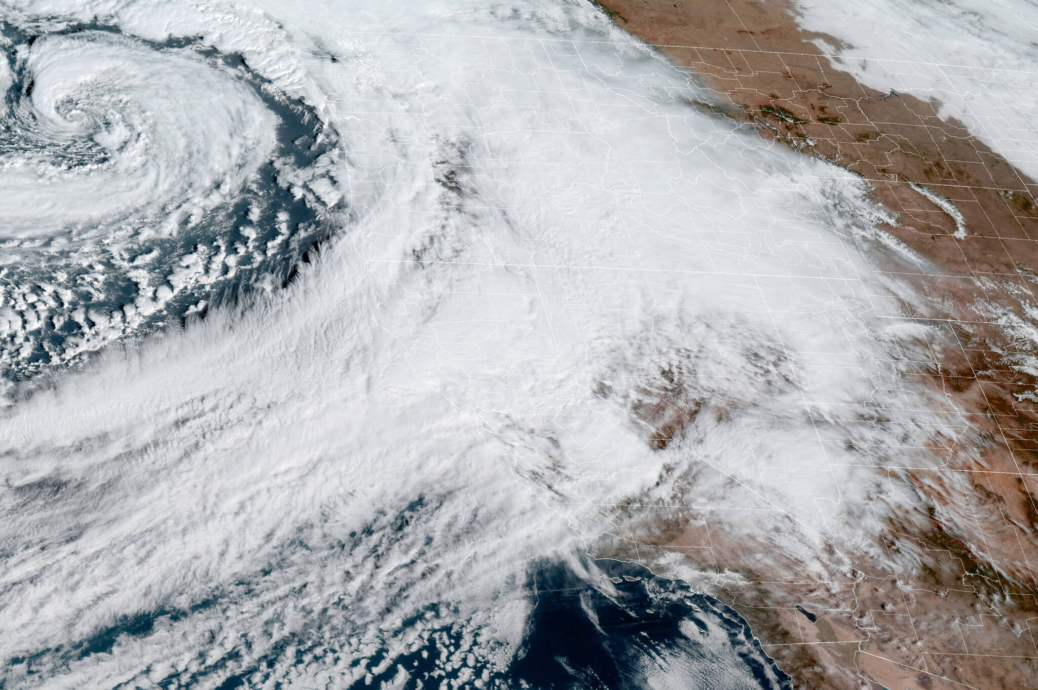 On Sunday, California bore the brunt of what meteorologists referred to as a bomb cyclone and an atmospheric river, a convergence of storms that brought more than half a foot of rain to parts of the Bay Area, along with high winds, concerns about flash floods and the potential for heavy snow in the Sierra Nevada. Much of the Bay Area was under a flash flood watch on Sunday, with the National Weather Service warning of the potential for mudslides across the region. (NOAA via The New York Times)